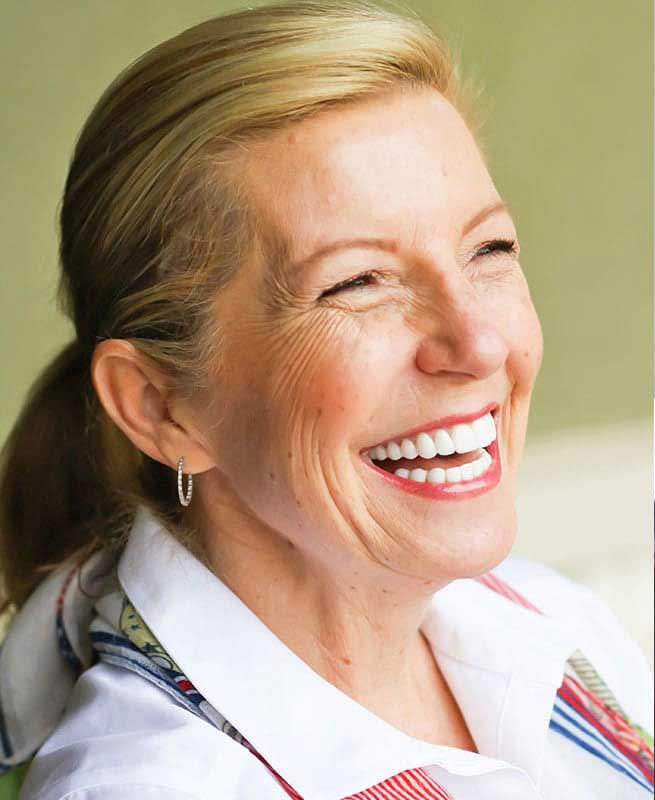 older woman smiling with white teeth